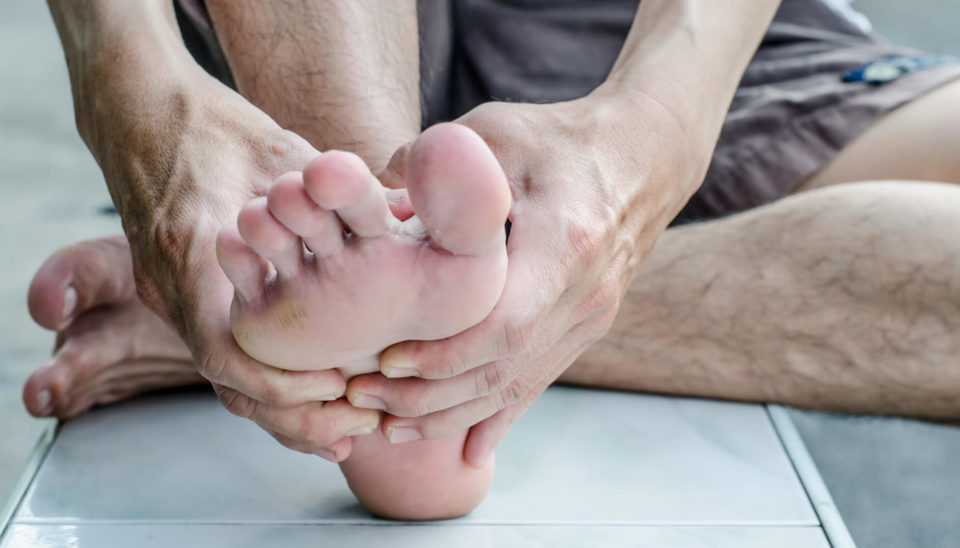 mans-hand-being-massaged-a-foot-sportreat-services-podiatry