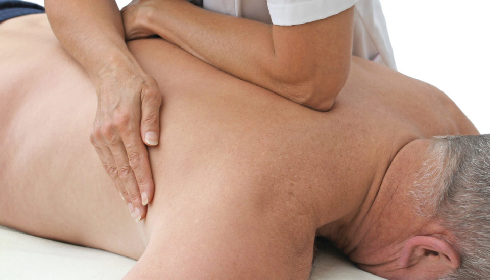 sports-massage-therapist-applying-pressure-to-male-prone-client-using-forearm-and-body-weight-sportreat-services-remedial-massage