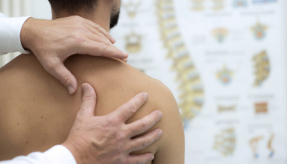 medical-check-at-the-shoulder-in-a-physiotherapy-center-sportreat-services-sports-medicine